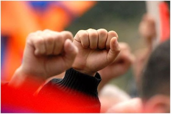 Photo of some fists held high in common protest